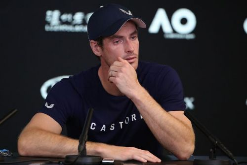 A sombre-looking Murray talks to the media while announcing his decision to retire