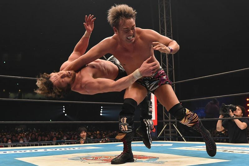 The Rainmaker Kazuchiko Okada delivers the Rainmaker clothesline to Kenny Omega