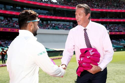 Rishabh Pant is exchanging a handshake with the legendary Glenn McGrath during the Pink Test
