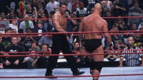 Mr. McMahon and Stone Cold circle as the 1999 Royal Rumble begins