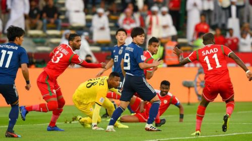 Oman in action against Japan at the Asia Cup (Image courtesy: AFC)