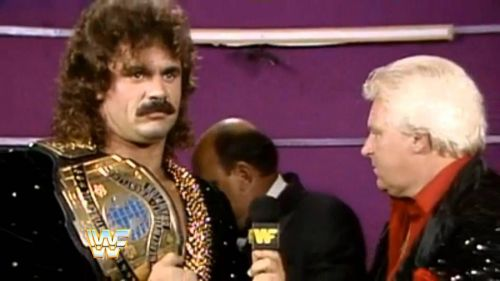 There's a reason Mean Gene Okerlund is hiding his face from Ravishing Rick Rude and Bobby the Brain Heenan in this classic clip.