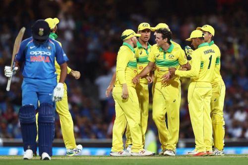 Rohit Sharma scored a century but Australia won the game by 34 runs