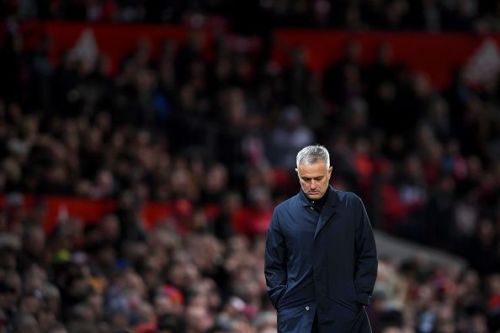 A dejected Mourinho trudges away, his back to a disgruntled fan base