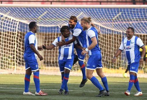 ITI's RC Prakash celebrates with Bengaluru FC stars Harmanjot Khabra and Erik Paartalu after scoring against HAL