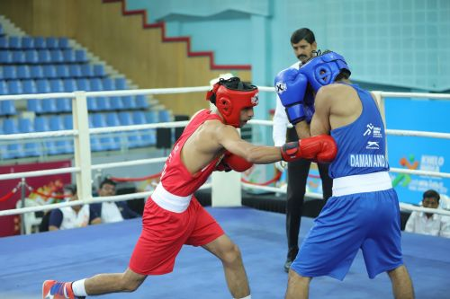 Ankit Narwal Narwal (Red) from Haryana in action during under-21 boys lightweight class (60kg) bout at Khelo India Youth Games