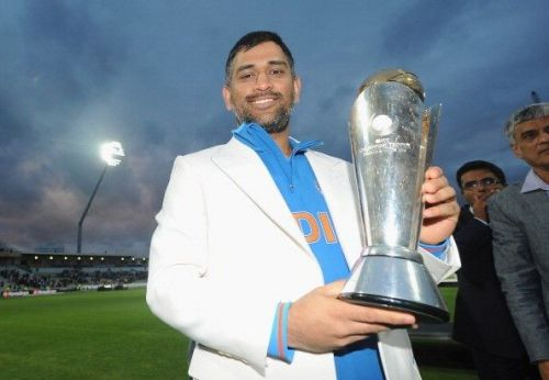 Dhoni with the Champions Trophy