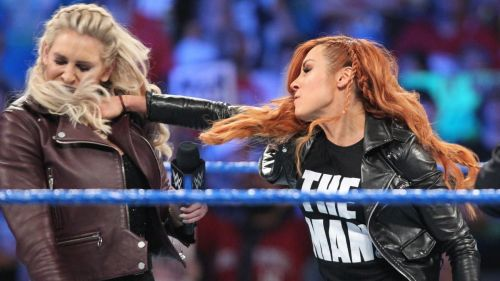 Suddenly, Becky strikes Charlotte in the face!