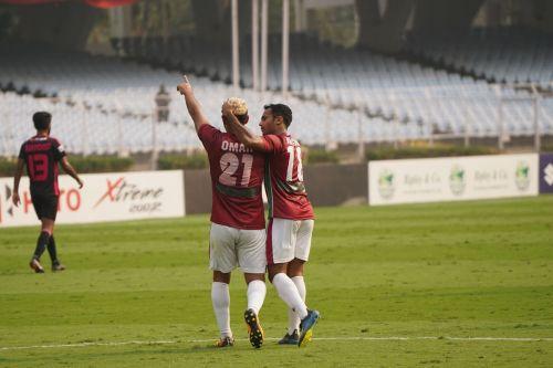 Omar celebrates with Abhishek Ambekar after scoring the goal