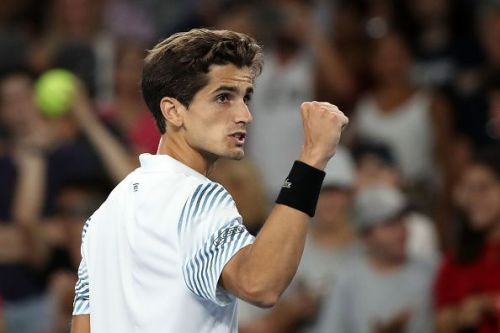 Pierre-Hugues Herbert pumps his fist in delight after getting past Hyeon Chung