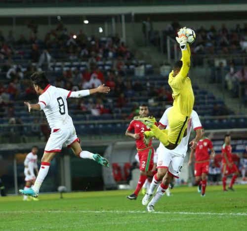 Faiz Al-Rushaidi of Oman with a leaping effort to catch the ball