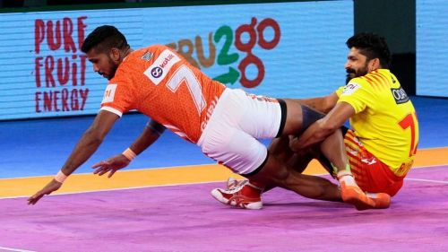 Koravi attempts a tackle on Pune's GB More