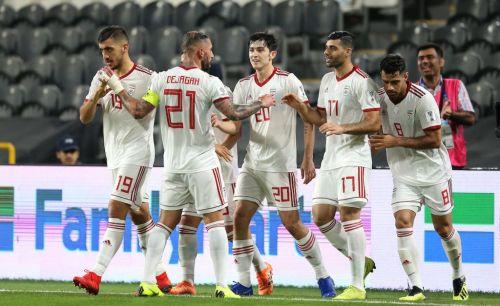 Iran players celebrate