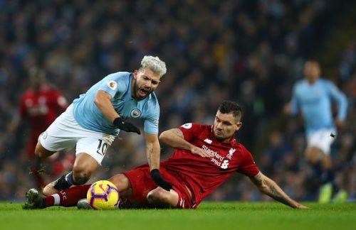 Lovren receives a yellow card for clattering into Aguero who is through on goal