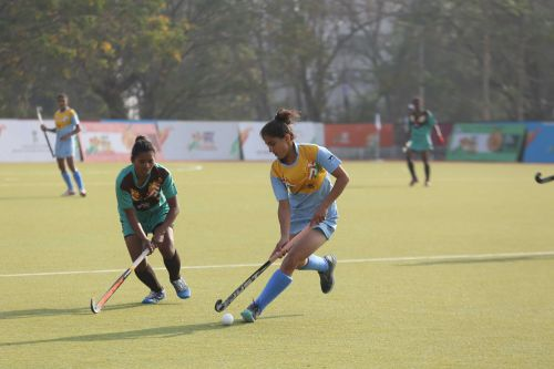 Haryana (in blue) in action against Jharkhand (in green) in the Girls U-21 Hockey Final at Khelo India Youth Games