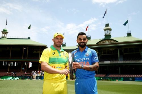 Aaron Finch and Virat Kohli posing with the Gillette ODI Trophy