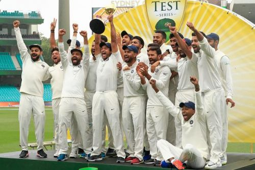 A jubilant Indian team lift the trophy after a 70 year wait to win a test series in Australia