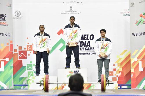U-21 Women's 71kg champion Akshata Kamati of Karnataka (middle) with her gold medal at Khelo India Youth Games