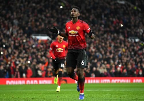 Pogba celebrates scoring a penalty v Brighton
