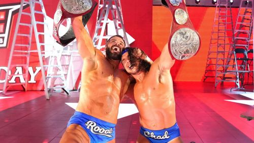 Bobby Roode and Chad Gable after winning Raw Tag Team Titles.