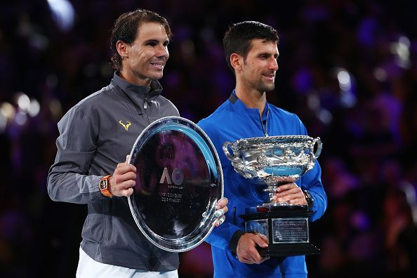 Djokovic (right) beat Nadal to lift the Australian Open trophy for a record 7th time