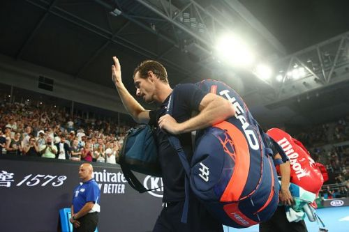 Murray waves goodbye to his fans as he leaves the Melbourne Arena