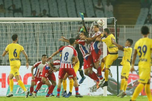 ATK and Kerala players wrestle for the ball