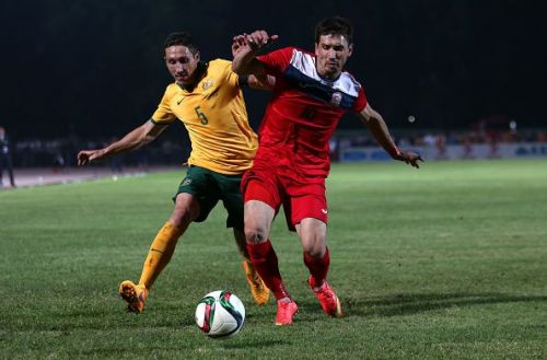 Mirlan Murzaev in action for Kyrgyzstan in red jersey v Australia - 2018 FIFA World Cup Qualifier