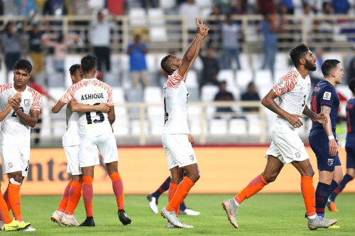 Indian players celebrate the first goal of the game.