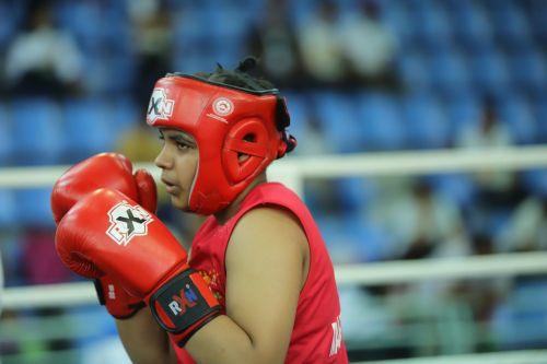 U-17 girls Welter (66kg) Gold medallist Mitika Gunele (Red) from Maharashtra in action