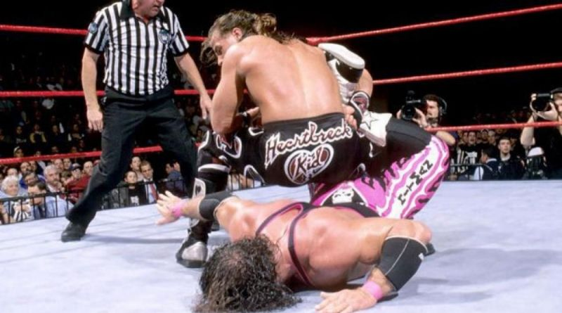 Bret Hart, trapped in his own finishing move the Sharpshooter, never tapped out but the bell rang anyway