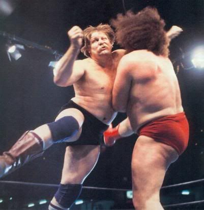 Stan Hansen decimates Andre the Giant with the Western Lariat.