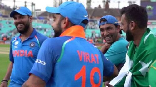 Indian and Pakistani senior players and staff share a laugh after the Champions Trophy final.