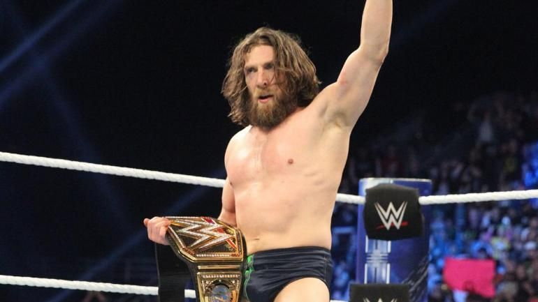 The New Daniel Bryan is shown holding the WWE Champion