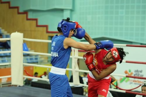 Shashi Chopra(Red) in action against Sakshi Choudhary ( Blue) during U-21 feather-weight section (57kg) at Khelo India Youth Games