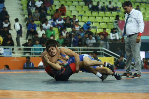 Wrestler Deepak Singh from J&K (in blue) in action against Maharashtra's Parveen in the boys U-17 freestyle wrestling 55kg weight category at the Khelo India Youth Games
