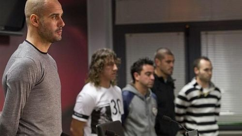 Guardiola with his players including Puyol and Xavi