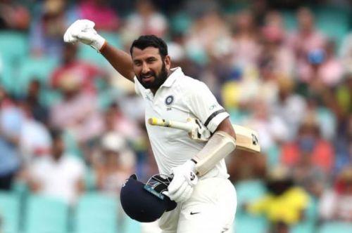 Pujara celebrating his third ton of the series
