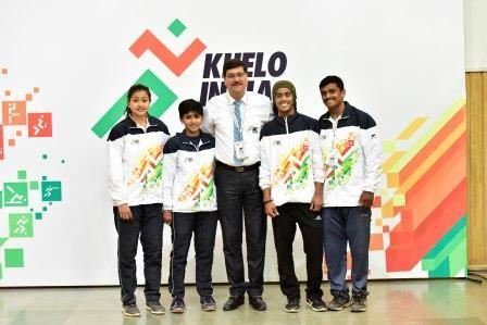 Sahdev Yadav, Secretary General of the Indian Weightlifting Federation  (IWLF) with young weightlifters at Khelo India Youth Games