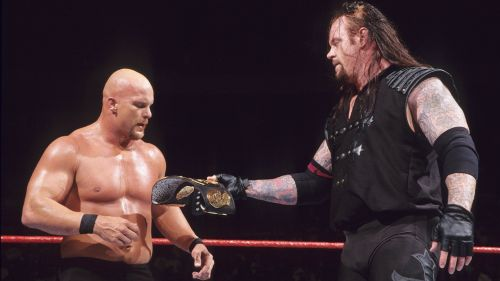 The Deadman hands Stone Cold the WWF Championship after their Summerslam 1998 bout