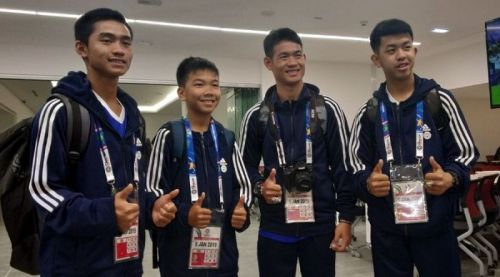 Members of the Moo Pa — Wild Boars — football team (from left) Adul Sam-on, Chanin Vibulrungruang, assistant coach Ekapol Chantawong (assistant coach) and Pornchai Kamluang at the Al Nahyan stadium in Abu Dhabi on Saturday. Image: Naveen