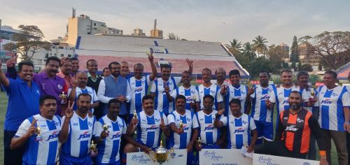 The ITI Legends' team celebrates after its win over HAL in an exhibition game at the Bangalore Football Stadium on Saturday