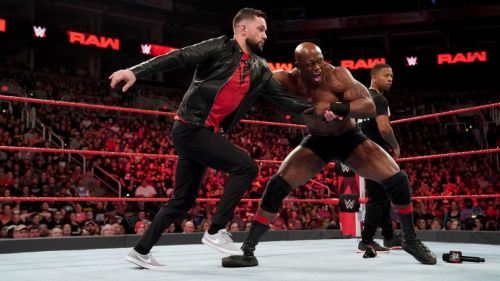 Finn Bálor gets brutalized by Bobby Lashley.