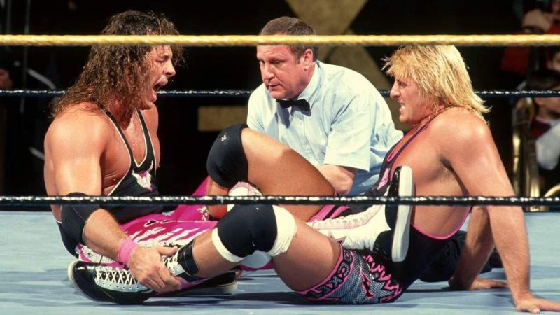 Brother vs. Brother: Bret Hart screams in agony as Owen Hart locks in a figure four leglock.