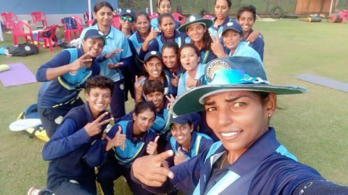 Saurashtra Women team sharing a light moment after winning the game.