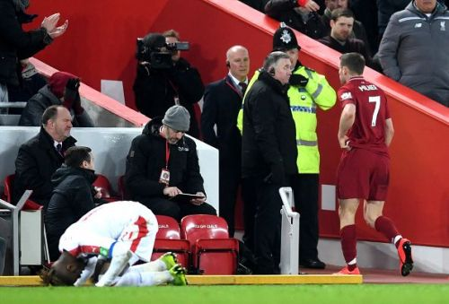 Milner walks off after his second yellow card