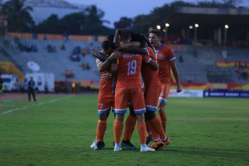 Chennai City players celebrate after a goal