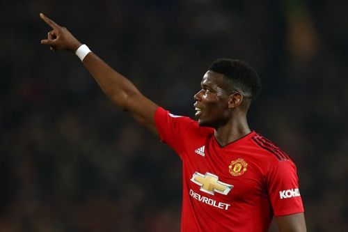 Paul Pogba celebrates after scoring a goal against Huddersfield