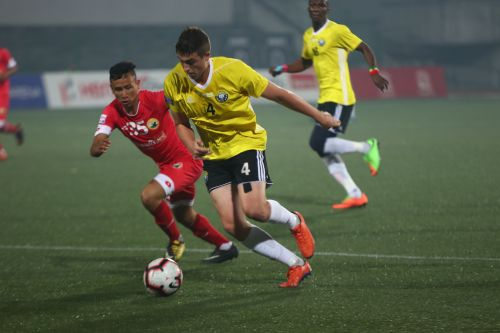 Shillong Lajong's Kenstar Kharsong tries to win the ball from Real Kashmir's Mason Robertson