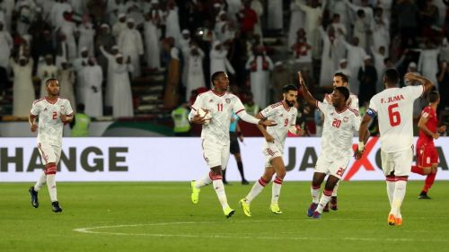 UAE players celebrate after scoring against Bahrain in the opening match